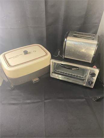 Electric Dutch oven by Presto,Hamilton Beach toaster,Kitchen Smith toaster oven.