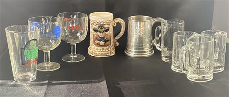 Lot of 9 beer glasses and steins.