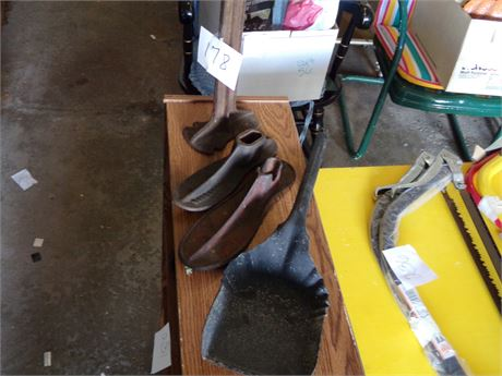 Cobbler Stand with 2 Different Shoes and Coal Shovel