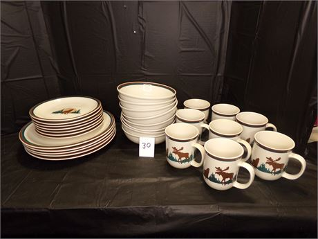 Set of dinnerware, Moose and wolf designs
