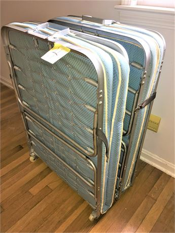 Two Burton-Dixie Roll-Away Beds