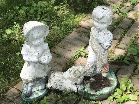 Boy and Girl Cement Figurines with Dog that is broken