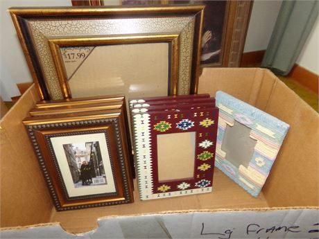 Picture Frames and Christmas and Elvis CD's and Antler Decorative and a Rock