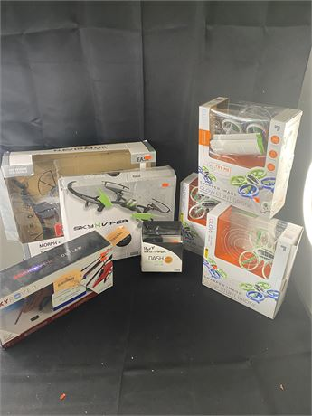 Lot of 7 toy drones.