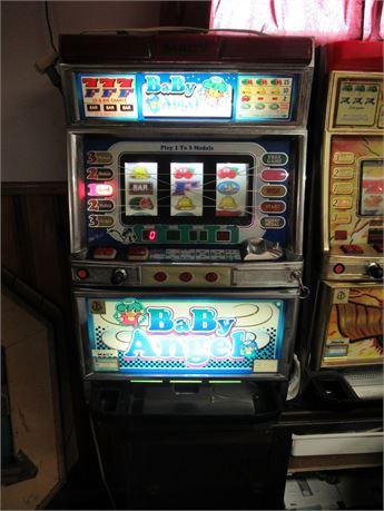 Macy Baby Angel Coin Slot Machine w/ Key. Powers On