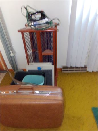 2 CD Racks, Iron, Rubbermaid Footrest, Trash Cans, and Suitcase