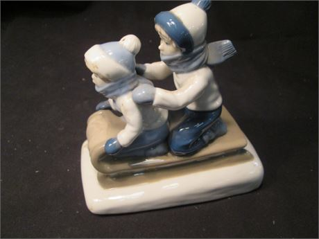 Vintage Faux LLadro China Boy & Girl Sledding Figurine
