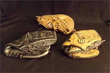 3 baseball gloves