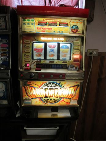 Ward of Lights Coin Slot Machine w/ Key. Powers On