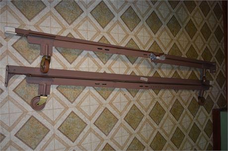 Adjustable bed rails on wheels