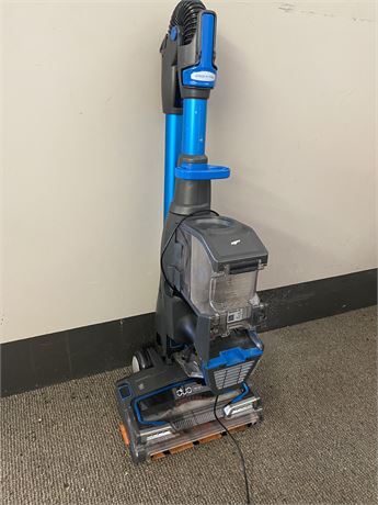 Shark duo clean cordless vacuum. Comes with charger. Needs battery.