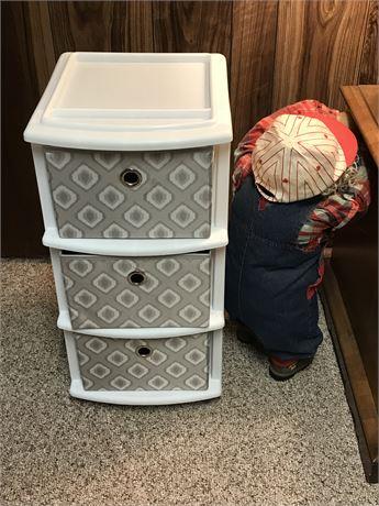 Organizing Bin and Stuffed Boy