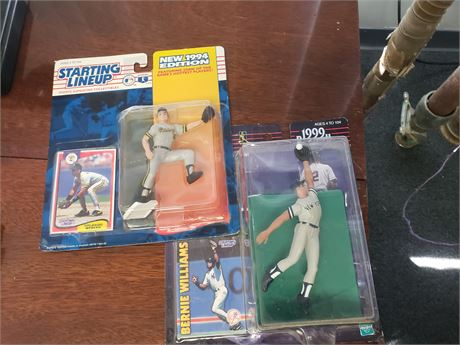Starting Lineup figures and 2 books of sports cards