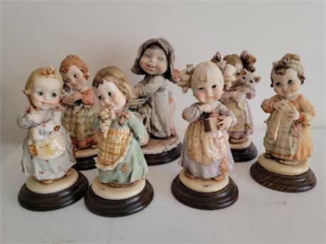 7 Armani Figurines
