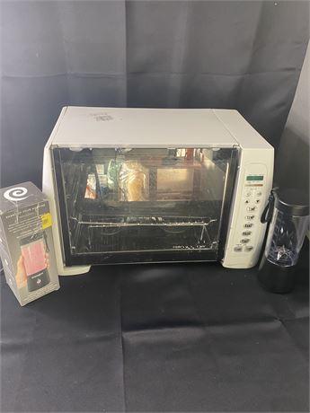 Toaster over broiler and 2 handheld blenders.