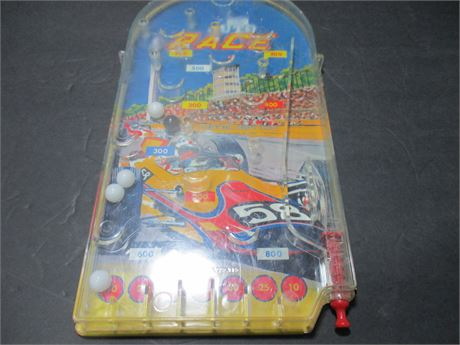 """Vintage 12""""  Wolverine Tin Hand Held Auto Race Pinball Manual Game Toy"""