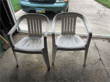 Two Outdoor Plastic Chairs