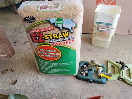 Grass Growing Lot: Seeding Straw Mulch and Sprinklers