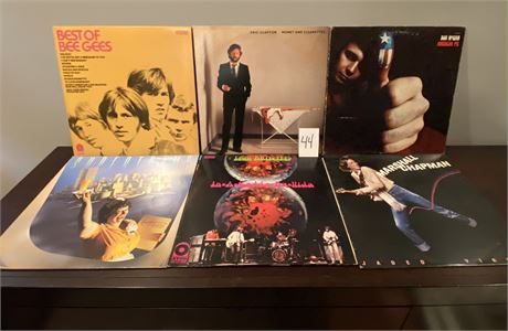 Vintage Vinyl Records Including Eric Clapton, Bee Gees, Iron Butterfly, and More