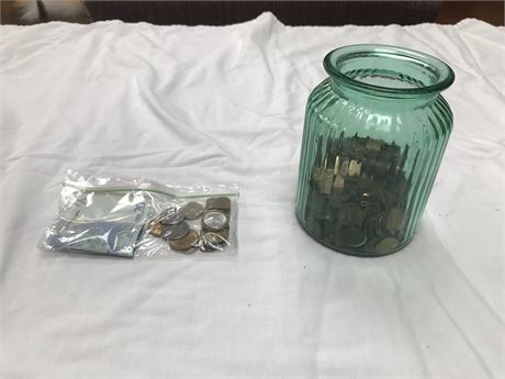Jar of Pennies with a Bag of Foreign Currency