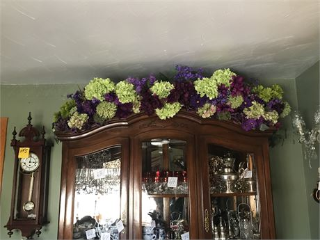 Faux Floral Arrangement on top of China Cabinet