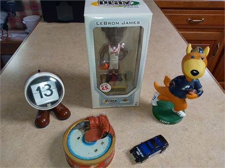 Bobbleheads, tin toy, etc